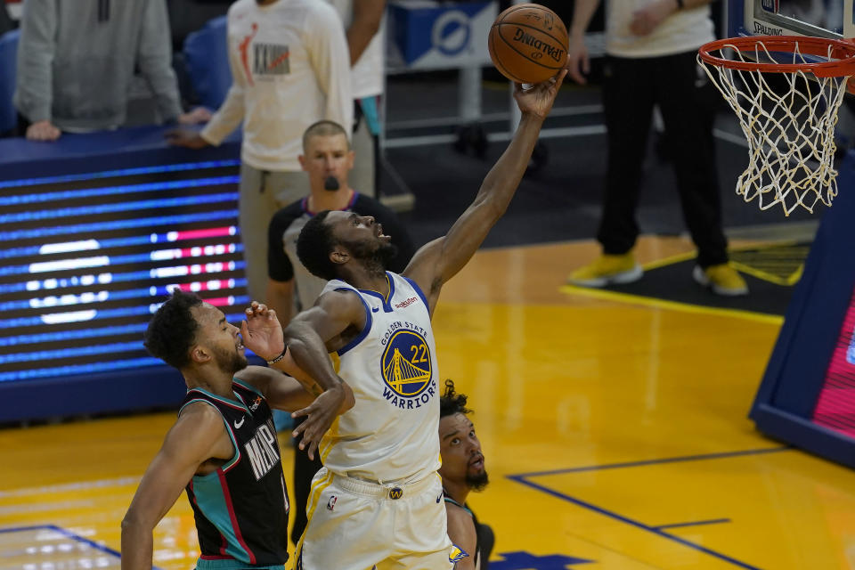 Golden State Warriors forward Andrew Wiggins (22) shoots against Memphis Grizzlies forward Kyle Anderson, left, and forward Dillon Brooks during the first half of an NBA basketball game in San Francisco, Sunday, May 16, 2021. (AP Photo/Jeff Chiu)