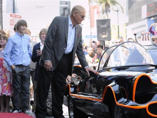 Adam West touches the original Batmobile at a ceremony where he received a star on the Hollywood Walk of Fame in Los Angeles, April 5, 2012.