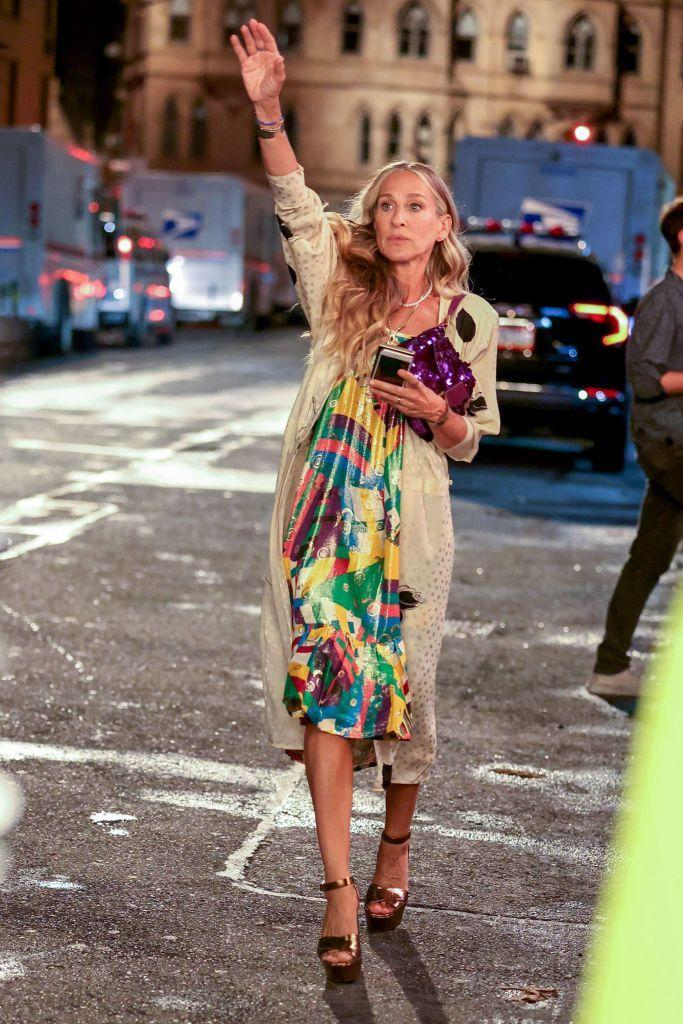 """<p>It's quite jarring seeing the SATC ladies with smart phones isn't it? Anyway... Parker's accessories game is on top form for the night out scene as she carries a vintage purple sequin Fendi baguette bag and stomps the streets of Manhattan in her YSL Farrah sandals.</p><p><a class=""""link rapid-noclick-resp"""" href=""""https://us.vestiairecollective.com/women-shoes/sandals/saint-laurent/farrah/"""" rel=""""nofollow noopener"""" target=""""_blank"""" data-ylk=""""slk:SHOP YSL FARRAH HEELS ON VESTIAIRE""""> SHOP YSL FARRAH HEELS ON VESTIAIRE</a></p>"""