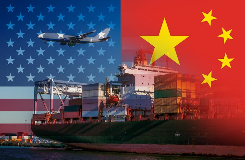 The American and Chinese flags imposed over shipping containers at a port with a plane flying over representing trade between the two countries.