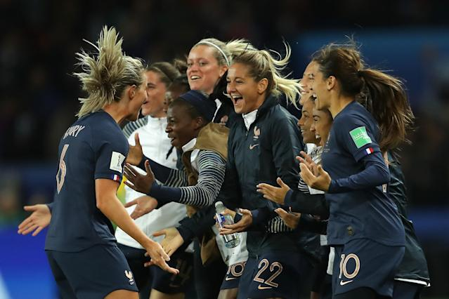Amandine Henry of France celebrates with teammates after scoring her team's fourth goal during the 2019 FIFA Women's World Cup France group A match between France and Korea Republic at Parc des Princes on June 07, 2019 in Paris, France. (Photo by Richard Heathcote/Getty Images)