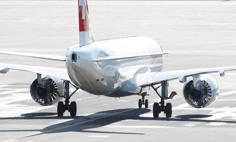 FILE PHOTO: Airbus A220 jet of Swiss Airlines is seen at Zurich airport in Zurich