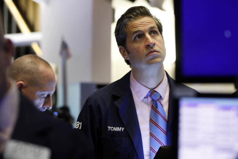 Trader Thomas Donato works on the floor of the New York Stock Exchange, Friday, Feb. 14, 2020. U.S. stocks wobbled between small gains and losses in early trading Friday as investors focused on another round of mostly solid corporate earnings. (AP Photo/Richard Drew)