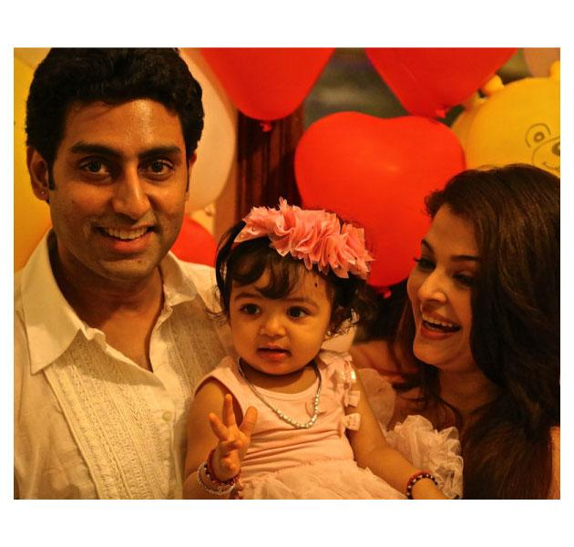 True to their word the Bachchans had a private party for their baby Aaradhya's birthday. Grandad Amitabh however tweeted a couple of pictures of the birthday baby with her parents.