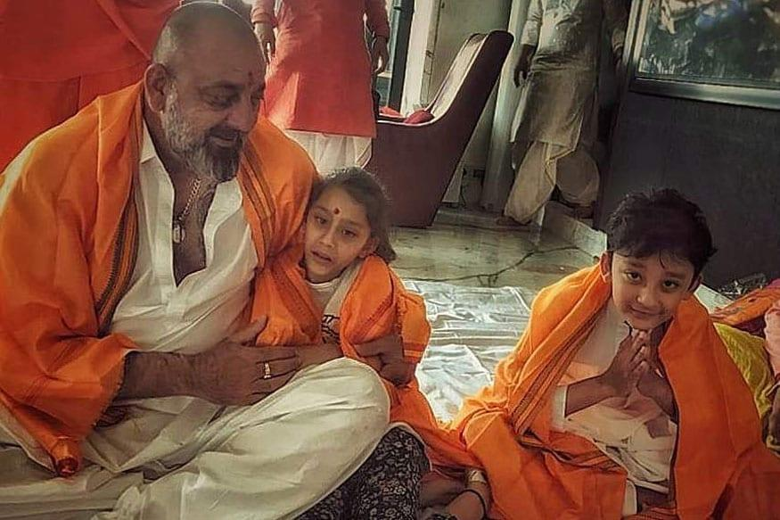 Sanjay Dutt shares a cute picture of his kids Shahraan and Iqra Dutt on Instagram, during Shiva puja he performed at his home. The actor also captioned it saying ' My world revolves around them!'