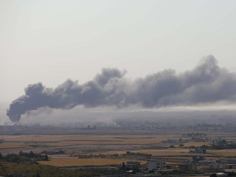 Smoke is seen over the Syrian town of Ras al-Ain as seen from the Turkish border town of Ceylanpinar on Saturday: REUTERS