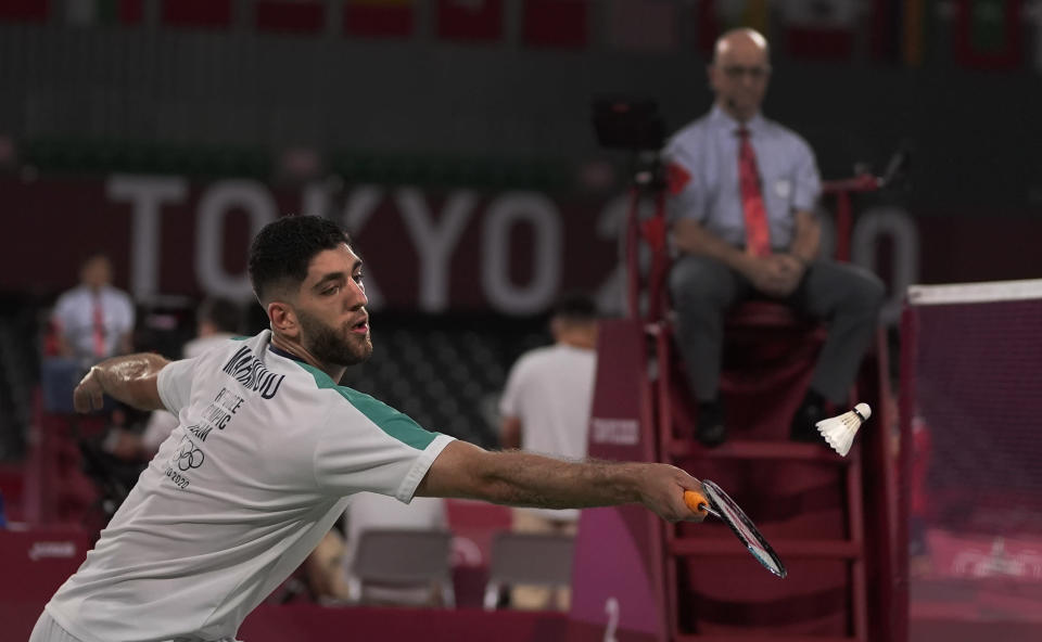 Refugee Olympic team's Aram Mahmoud plays against Kean Yew Loh of Singapore during men's singles Badminton match at the 2020 Summer Olympics, Monday, July 26, 2021, in Tokyo, Japan. (AP Photo/Markus Schreiber)