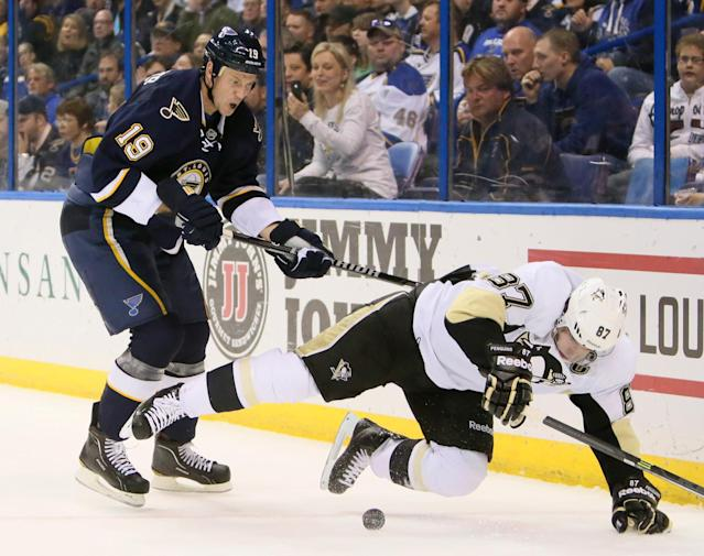 St. Louis Blues defenseman Jay Bouwmeester (19) knocks down Pittsburgh Penguins center Sidney Crosby in second-period NHL hockey game action on Saturday, Nov. 9, 2013, in St. Louis. (AP Photo/St. Louis Post-Dispatch, Chris Lee)