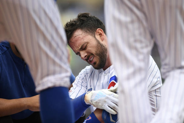 Chicago Cubs' Kris Bryant reacts after getting hurt while sliding into first base during the third inning of a baseball game against the St. Louis Cardinals, Sunday, Sept. 22, 2019, in Chicago. (AP Photo/Paul Beaty)