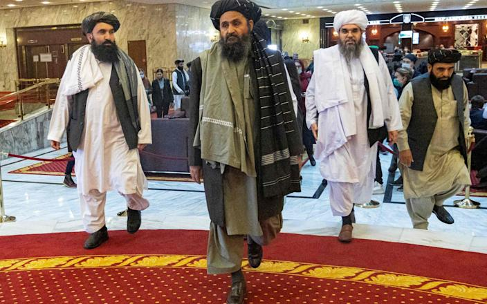 Taliban co-founder Mura Abdul Ghani Baradar (C) and other members of the Taliban delegation attend an international conference on Afghanistan on the peaceful resolution of the conflict in Moscow on March 18, 2021. Arrived to-AFP