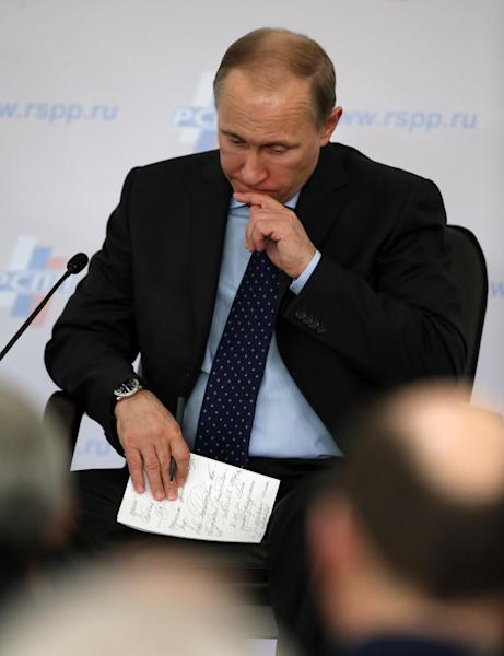 Russia's President Vladimir Putin attends a congress of the Russian Union of Industrialists and Entrepreneurs in Moscow, Russia, on Thursday, March 20, 2014. (AP Photo/ Sergei Chirikov, pool)