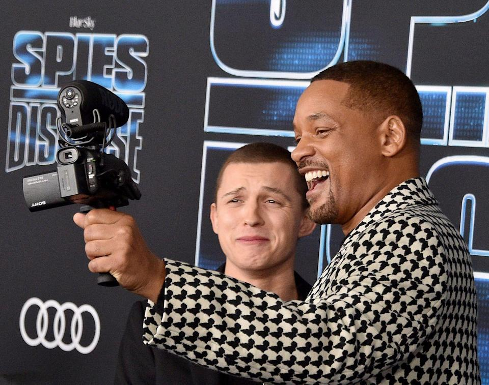 <p>Will Smith and Tom Holland arrive at the premiere of <em>Spies In Disguise </em>at El Capitan Theatre on December 4, 2019 in Los Angeles, California.</p>