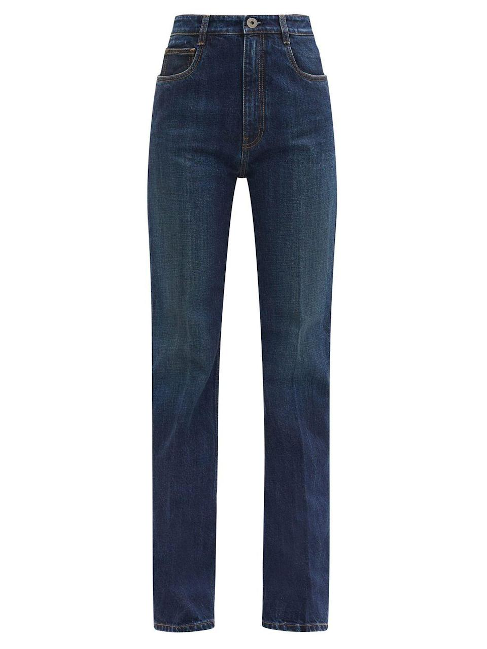 """<p>High-rise flared jeans, £530, Prada at Matchesfashion.com.</p><p><a class=""""link rapid-noclick-resp"""" href=""""https://go.redirectingat.com?id=127X1599956&url=https%3A%2F%2Fwww.matchesfashion.com%2Fproducts%2FPrada-High-rise-flared-jeans-1377234&sref=https%3A%2F%2Fwww.townandcountrymag.com%2Fuk%2Fstyle%2Ffashion%2Fg35053771%2Fnew-years-eve-party%2F"""" rel=""""nofollow noopener"""" target=""""_blank"""" data-ylk=""""slk:SHOP NOW"""">SHOP NOW</a> </p>"""