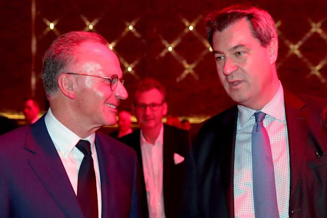 Bayern Munich's CEO Karl-Heinz Rummenigge talks to Bavarian Prime Minister Markus Soeder while celebrating winning the Bundesliga trophy at the Nockherberg beer garden in Munich, Germany, May 12, 2018. Picture taken May 12, 2018. Alexander Hassenstein/Pool via Reuters