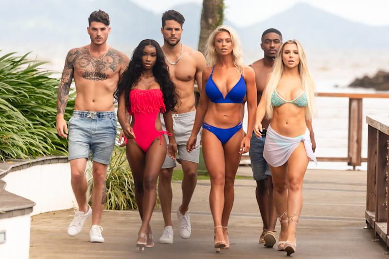"""SUVA - JULY 21: Love Island - Pictured: Eric Hall, Aissata Diallo, George Johnson, Kelsey Jenkins, Ray Gantt and Marlisse """"Marli"""" Tyndall. The tenth episode of Love Island airs Monday, July 22 (8:00-9:00 PM, ET/PT). New one-hour episodes continue every weeknight through Wednesday, August 7 (8:00-9:00 PM, ET/PT). (Photo by Colin Young-Wolff/CBS via Getty Images)"""