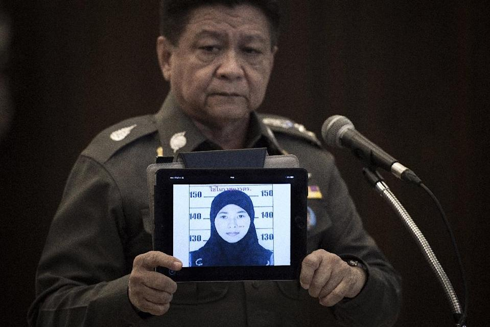 Thailand's police spokesman Prawut Thavornsiri holds a tablet displaying a picture of Wanna Suansan, 26, wanted for questioning after bomb making materials were found in a Bangkok apartment she allegedly rented (AFP Photo/Nicolas Asfouri)