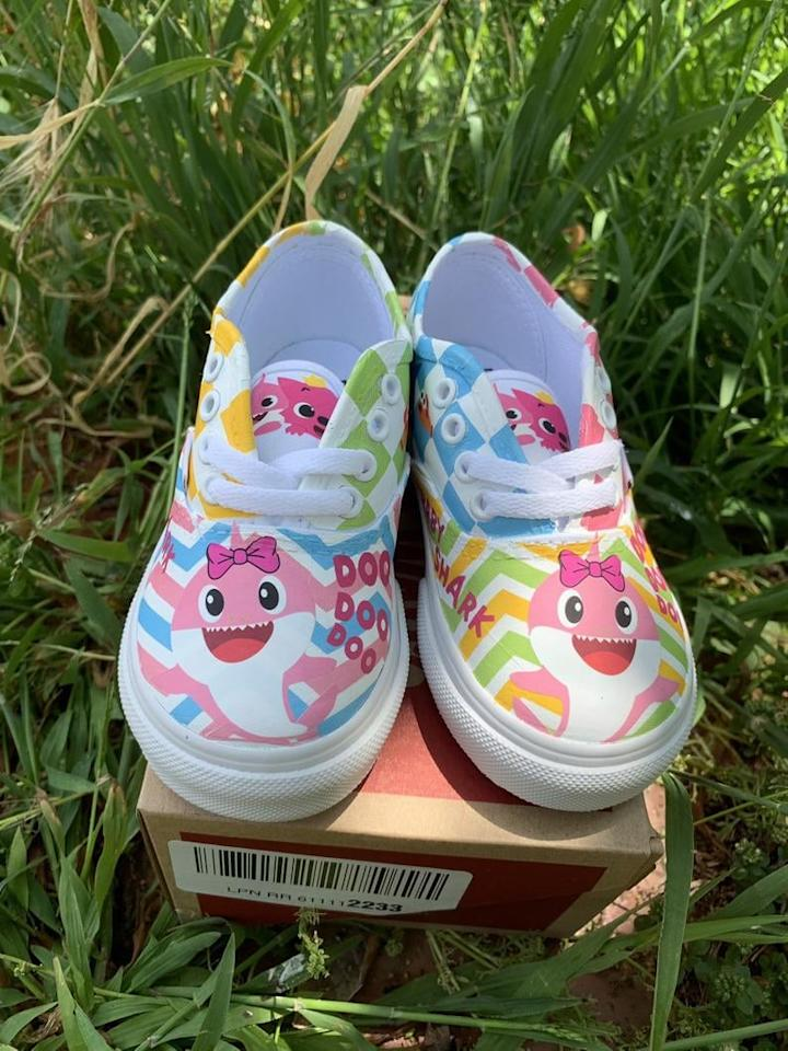 "<p>We're completely loving the playful chevron pattern on these <a href=""https://www.popsugar.com/buy/Baby-Pink-Shark-Custom-Vans-480346?p_name=Baby%20Pink%20Shark%20Custom%20Vans&retailer=etsy.com&pid=480346&price=70&evar1=moms%3Aus&evar9=46502425&evar98=https%3A%2F%2Fwww.popsugar.com%2Ffamily%2Fphoto-gallery%2F46502425%2Fimage%2F46502435%2FBaby-Pink-Shark-Custom-Vans&list1=toddlers%2Cetsy%2Cbabies%2Ckid%20shopping%2Cgifts%20for%20babies%2Cgifts%20for%20toddlers%2Cbaby%20shark&prop13=api&pdata=1"" rel=""nofollow"" data-shoppable-link=""1"" target=""_blank"" class=""ga-track"" data-ga-category=""Related"" data-ga-label=""http://www.etsy.com/listing/705856973/baby-pink-shark-custom-kids-vans?ga_order=most_relevant&amp;ga_search_type=all&amp;ga_view_type=gallery&amp;ga_search_query=baby+shark+vans&amp;ref=sr_gallery-1-11&amp;organic_search_click=1&amp;cns=1"" data-ga-action=""In-Line Links"">Baby Pink Shark Custom Vans</a> ($70 and up). And the laces add a sweet touch!</p>"