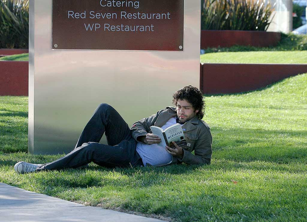 """Entourage"" star Adrian Grenier lived up to his easy-going reputation when he curled up on the grass with a meditation book. RSPress/<a href=""http://www.splashnewsonline.com"" target=""new"">Splash News</a> - December 12, 2007"