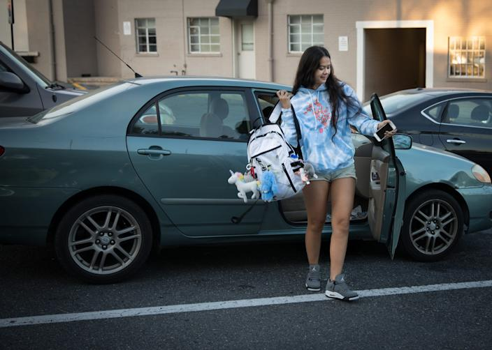 Sky Bloomer, 18, jumps out of a friend's car as they head to Montgomery Blair High School in Silver Spring, Md., on September 25, 2019.
