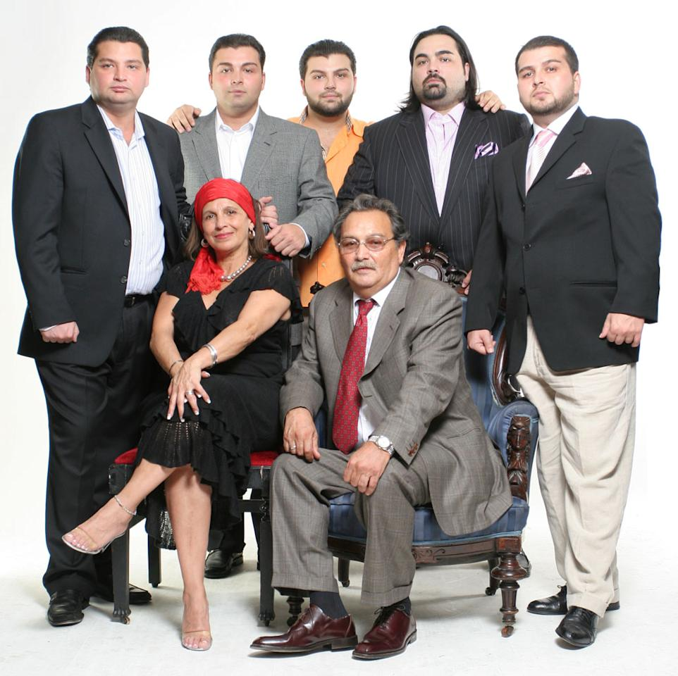 """The Johns family is one of Manhattan's most prominent Romani, or """"Gypsy"""" families. In each episode of this new series, cameras document their efforts to preserve Romani customs amid the vices of the city, while upholding their family's power in the community and expanding their psychic shop empire.<br><br>Front Row (L-R): Tina and Bob, Sr.<br>Back Row (L-R): Nicky, Joey, Jack, Bobby, and Erik -- Tina and Bob's five sons"""