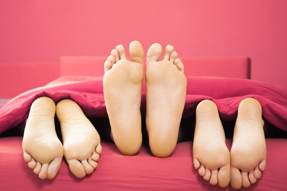 domestic life: threesome sharing the same bed