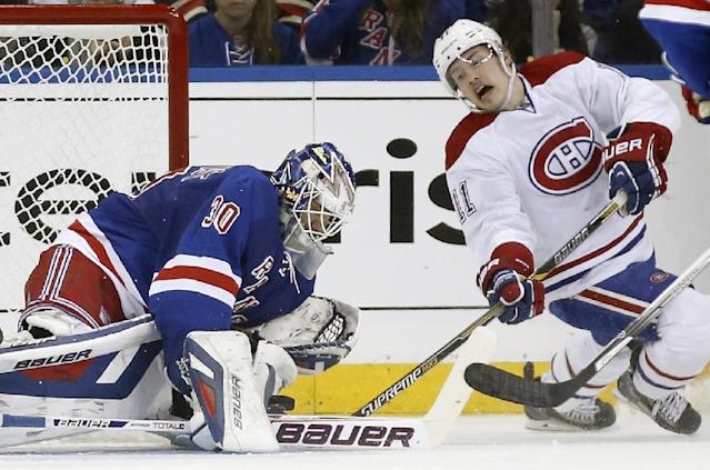 Montreal Canadiens right wing Brendan Gallagher (11) takes a shot as New York Rangers goalie Henrik Lundqvist (30) of Sweden makes a save in the second period of Game 3 of the NHL hockey Stanley Cup playoffs Eastern Conference finals, Thursday, May 22, 2014, in New York. (AP Photo/Kathy Willens)
