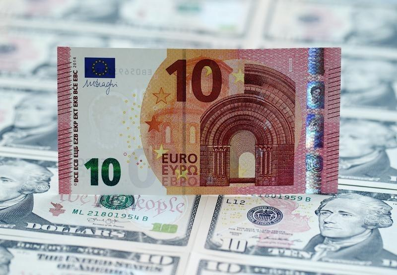 A photo illustration shows U.S. Dollar and euro banknotes in Vienna