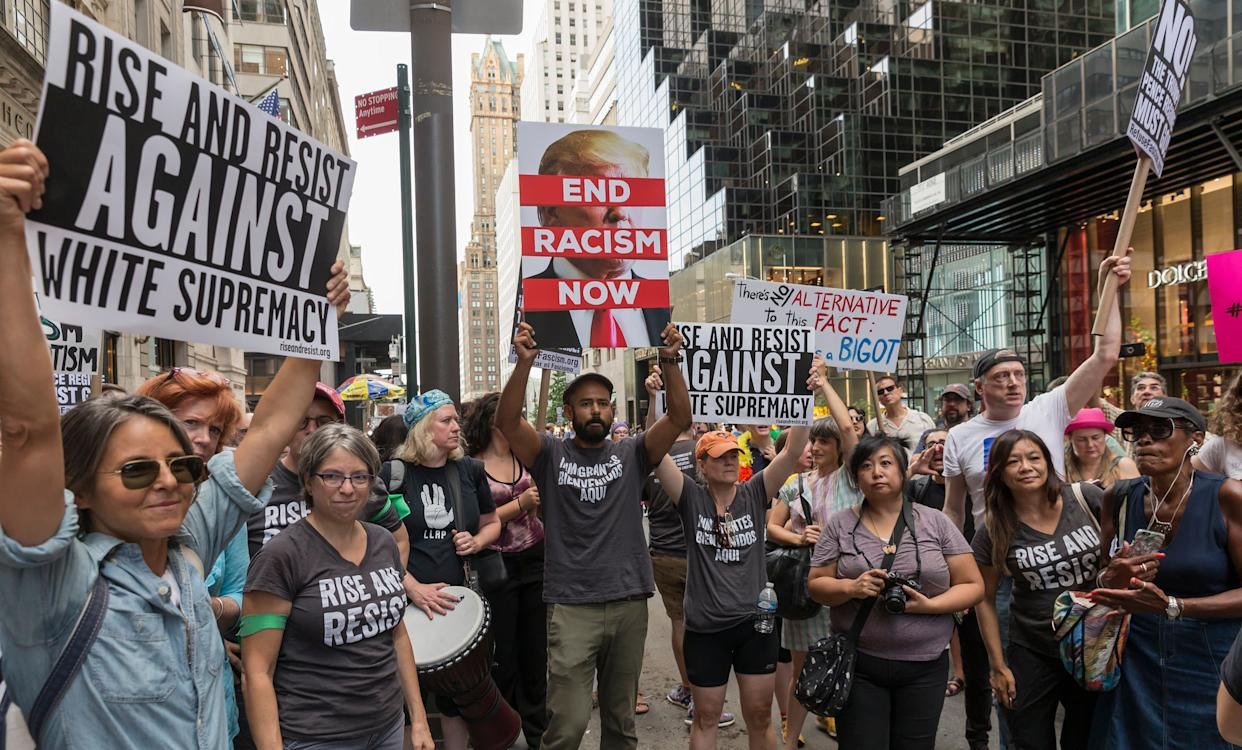 Ahead of President Donald Trump's visit, about 400 demonstrators on FifthAvenue near Trump Tower in New York attend a rally protesting the violencein Charlottesville.