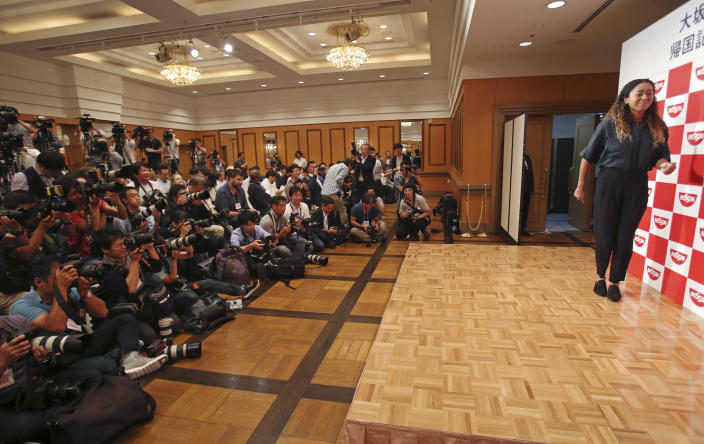 Naomi Osaka, the champion of U.S. Open women's singles, arrives for a press conference in Yokohama, Thursday, Sept. 13, 2018. Osaka defeated Serena Williams of the U.S. on Saturday, Sept. 8, to become the first Grand Slam singles champion from Japan. (AP Photo/Koji Sasahara)