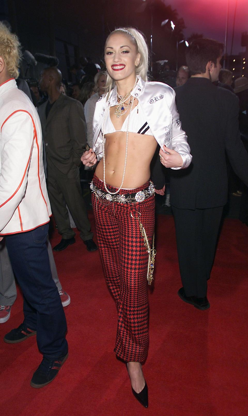 <p>At the 2001 Billboard Music Awards wearing a white bikini top, cropped jacket, and plaid pants.</p>