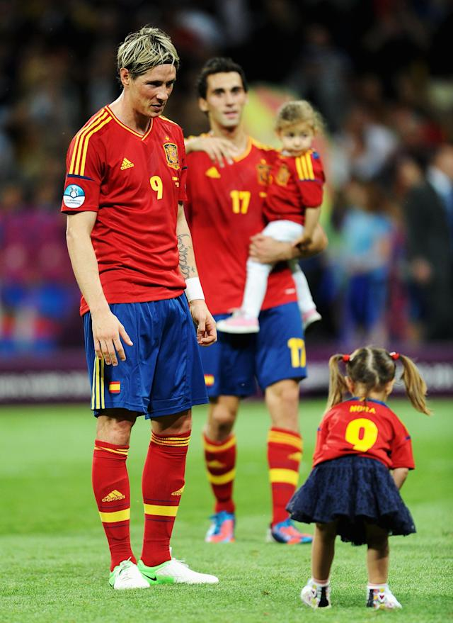 KIEV, UKRAINE - JULY 01: Fernando Torres of Spain watches his daughter Nora Torres after the UEFA EURO 2012 final match between Spain and Italy at the Olympic Stadium on July 1, 2012 in Kiev, Ukraine. (Photo by Jasper Juinen/Getty Images)