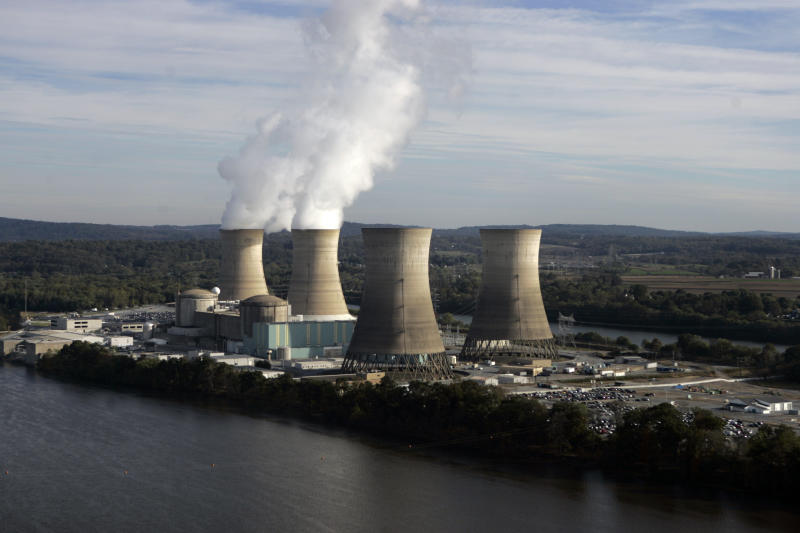 FILE - In this Oct. 19, 2005, file photo, steam billows from two active cooling towers of the Three Mile Island nuclear power plant in Middletown, Pa. The owner of Three Mile Island, site of the United States' worst commercial nuclear power accident, is acknowledging in a Wednesday, May 8, 2019, statement that it is unlikely to get a financial rescue from Pennsylvania and says it plans to go through with a shutdown starting June 1. (AP Photo/Carolyn Kaster, File)