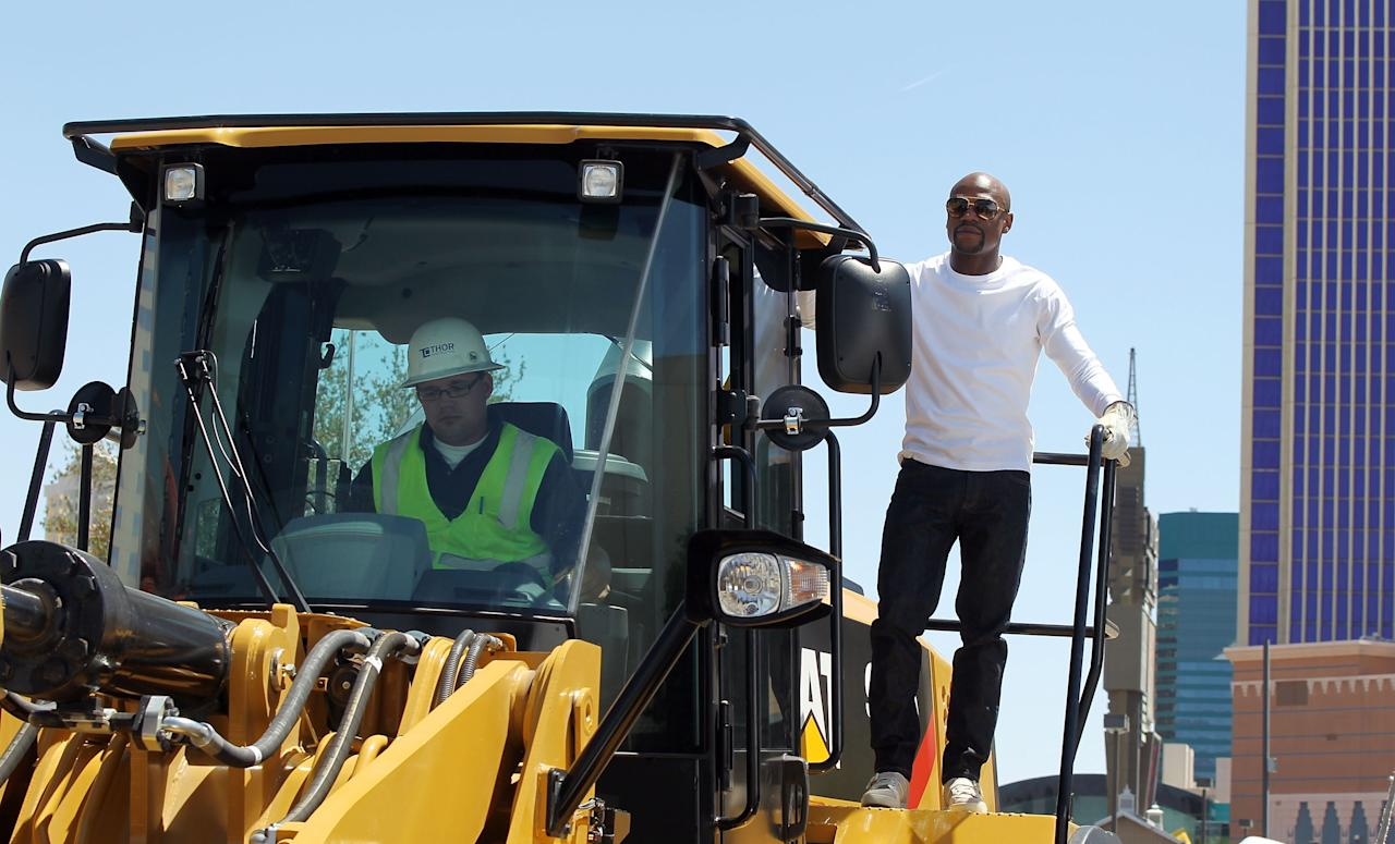 LAS VEGAS, NV - MAY 01: WBC welterweight champion Floyd Mayeather Jr. arrives on a bull dozer during a groundbreaking for a USD 375 million, 20,000-seat sports and entertainment arena being built by MGM Resorts International and AEG on May 1, 2014 in Las Vegas, Nevada. The arena is scheduled to open in early 2016. (Photo by Isaac Brekken/Getty Images for MGM Resorts)