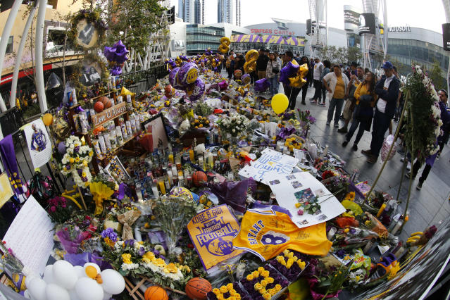 Thousands of items left at Staples Center in honor of Kobe Bryant will end up at the Lakers legend's house. (AP Photo/Ringo H.W. Chiu)
