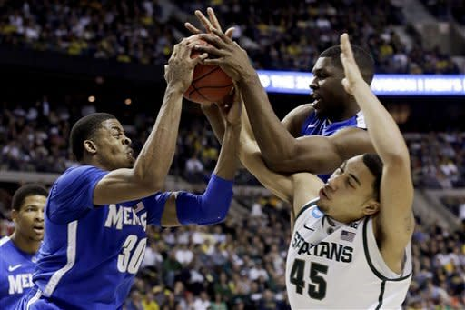 Memphis forward D.J. Stephens (30) and Adonis Thomas battle for a rebound with Michigan State guard Denzel Valentine (45) in the second half of their third-round game of the NCAA college basketball tournament in Auburn Hills, Mich., Saturday March 23, 2013. Michigan State won 70-48. (AP Photo/Paul Sancya)