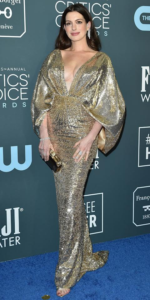 <p>At the Critics' Choice Awards, Anne Hathaway posed for the cameras in a plunging Versace gown covered in sequins.</p>