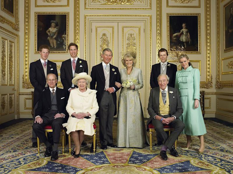 The Prince of Wales and his new bride Camilla, Duchess of Cornwall, with their families (L-R back row) Prince Harry, Prince William, Tom and Laura Parker Bowles (L-R front row) Duke of Edinburgh, Britain's Queen Elizabeth II and Camilla's father Major Bruce Shand, in the White Drawing Room at Windsor Castle after their wedding ceremony, April 9, 2005 in Windsor, England.