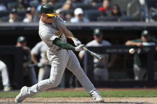 Oakland Athletics' Matt Chapman hits an RBI double during the seventh inning of a baseball game against the New York Yankees, Saturday, Aug. 31, 2019, in New York. (AP Photo/Mary Altaffer)