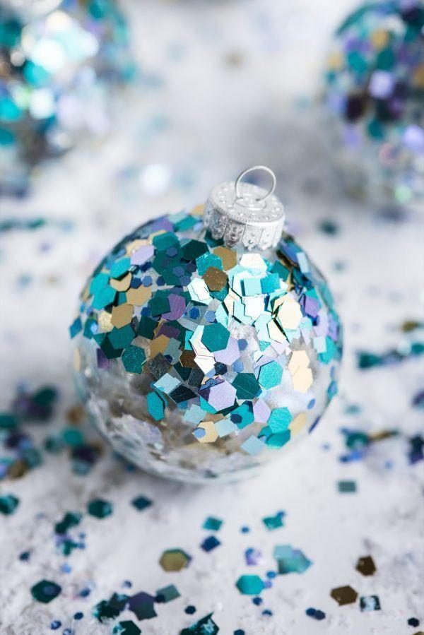 """<p>What makes glitter even better? When it's bigger and in confetti form, of course! Plus, you honestly can craft these stunning ornaments in minutes.</p><p><strong>Get the tutorial at <a href=""""https://thesweetestoccasion.com/2016/12/diy-glitter-confetti-ornaments/"""" rel=""""nofollow noopener"""" target=""""_blank"""" data-ylk=""""slk:The Sweetest Occasion"""" class=""""link rapid-noclick-resp"""">The Sweetest Occasion</a>.</strong></p><p><a class=""""link rapid-noclick-resp"""" href=""""https://www.amazon.com/Aleenes-Spray-Finish-Acrylic-Sealer/dp/B003W0A19U/?tag=syn-yahoo-20&ascsubtag=%5Bartid%7C10050.g.28831556%5Bsrc%7Cyahoo-us"""" rel=""""nofollow noopener"""" target=""""_blank"""" data-ylk=""""slk:SHOP SPRAY SEALER"""">SHOP SPRAY SEALER</a></p>"""