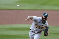 Oakland Athletics starting pitcher Mike Fiers throws to a Seattle Mariners batter during the first inning of a baseball game Saturday, Aug. 1, 2020, in Seattle. (AP Photo/Elaine Thompson)