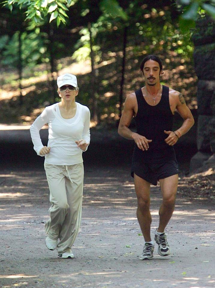 """Madonna and Carlos Leon, her former personal trainer (and the father of her daughter, Lourdes), make a mad dash through Central Park. <a href=""""http://www.infdaily.com"""" target=""""new"""">INFDaily.com</a> - June 26, 2007"""