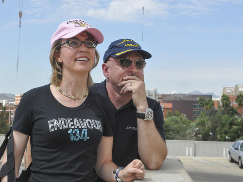 In this photo provided by the Southwest Photo Bank, former U.S. Rep. Gabrielle Giffords and husband, former astronaut Mark Kelly, watch the Space Shuttle Endeavor fly over Tucson, Ariz. on its way to Los Angeles, Thursday, Sept. 20, 2012. Kelly, Endeavour's last commander, requested that the shuttle pass over Tucson to honor Giffords, who is recovering after suffering a head wound in a shooting rampage last year. (AP Photo/Southwest Photo Bank, P.K. Weis) MANDATORY CREDIT