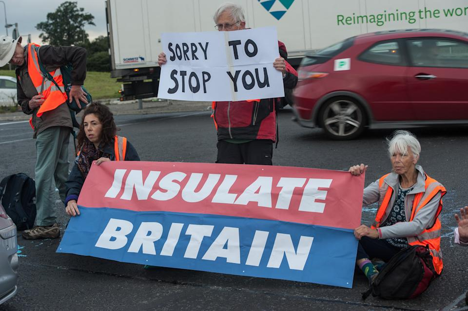 HATFIELD, HERTFORDSHIRE - SEPTEMBER 20: The traffic is brought to a standstill as protestors from Insulate Britain block a major roundabout near the A1(M) on September 20, 2021 in Hatfield, England. (Photo by Guy Smallman/Getty Images)