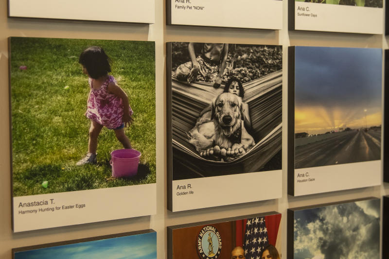 A photo of the family dog with kids in monochrome stands out on a colorful wall. (Photo: Gordon Donovan/Yahoo News)