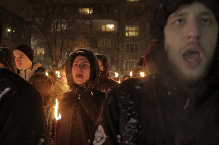 Bulgarian far-right nationalists chant slogans as they gather in the country's capital, to honour a World War II general known for his anti-Semitic and pro-Nazi activities, in Sofia, Saturday, Feb. 13, 2021. Braving sub-zero temperatures, hundreds of dark-clad supporters of the Bulgarian National Union group flocked to a central square where they had planned to kick off the annual Lukov March, a torch-lit procession held every February to the former house of Gen. Hristo Lukov. (AP Photo/Valentina Petrova)