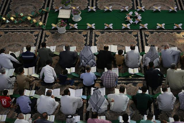 <p>Men read the Quran at the Imam Hussein shrine during the Muslim holy month of Ramadan in the city of Karbala, Iraq, May 29, 2017. (Stringer/Reuters) </p>