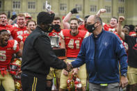 VMI Superintendent Maj. Gen. Cedric T. Wins, left, receives the Silver Shako Trophy from The Citadel's Senior Associate Athletic Director Geoff Von Dollen after they defeated The Citadel in an NCAA college football game, Saturday, April 17, 2021, in Lexington, Va. (David Hungate/Roanoke Times via AP)