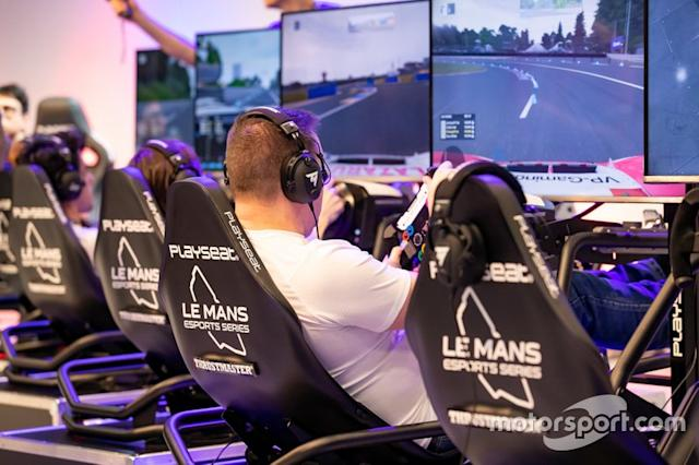 """A fan uses one of the Le Mans eSports Series simulator rigs <span class=""""copyright"""">Paul Foster</span>"""