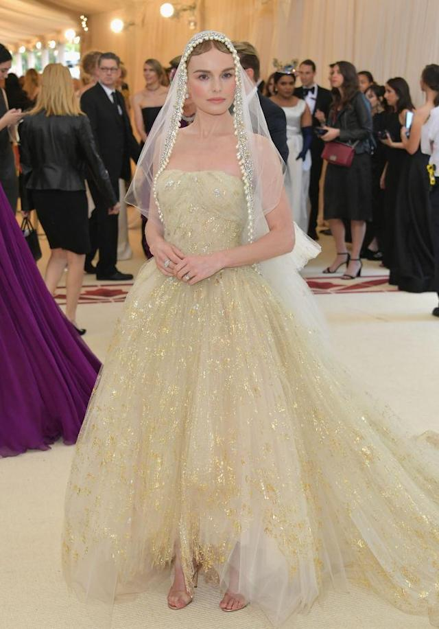 <p>Bosworth channeled a porcelain doll in this Oscar de la Renta gown and veil. (Photo: Getty Images) </p>