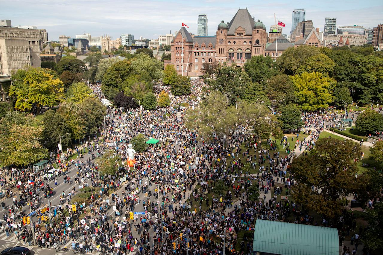 People take part in a climate change strike in Toronto, Ontario, Canada September 27, 2019. REUTERS/Carlos Osorio